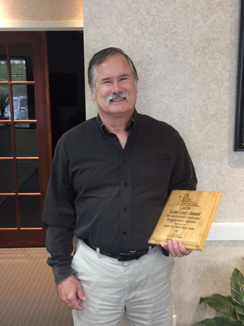 Mike Burton Holds His Gold Leaf Award